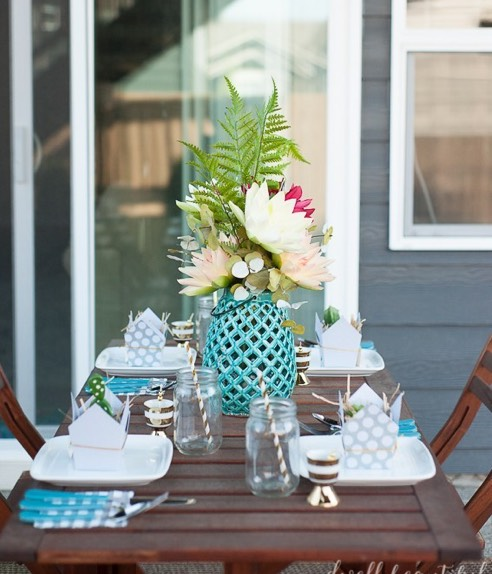 Cute, spring patio set up on a wooden outdoor table.